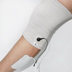 Opaska przewodząca na kolano RoovJoy do elektrostymulacji